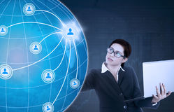 Female worker touching social network icon Stock Photo