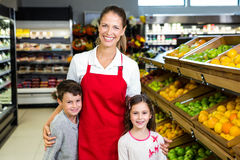 Female worker with two kids Royalty Free Stock Photography