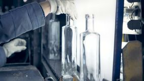 Woman checks bottles` quality, close up. stock video