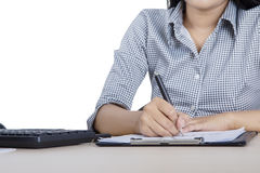 Female worker using pen on studio Stock Photo