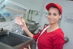 Female worker vacuum preserved food Stock Images