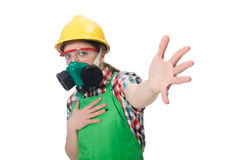 Female worker wearing coverall and gas mask Stock Image