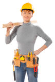Female worker wearing working clothes holding wooden planks Royalty Free Stock Photo