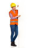 Female Worker And White Banner Stock Photo