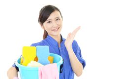 A female Janitorial cleaning service. The female worker who poses happy on white background Royalty Free Stock Photos