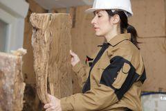 Female worker working with insulation boards royalty free stock image