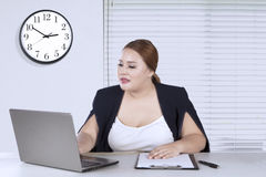 Female worker working with laptop Royalty Free Stock Photo