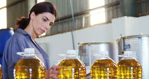 Female worker working in oil factory stock video footage