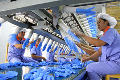 Female workers on the acrylonitrile butadiene gloves production Royalty Free Stock Photo