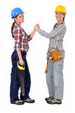 Female workers forming a pact Stock Photo