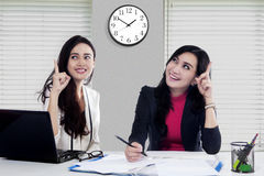 Female workers get smart idea Stock Images