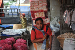 Female workers in traditional markets in Indonesia. Women work as porters in traditional market in Solo, Indonesia. Within a day they only earn 5 dollars Royalty Free Stock Photography