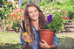 Female working at garden Royalty Free Stock Image