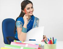 Female working at her desk Stock Photo