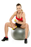 A female working out with a dumb bell Royalty Free Stock Photography