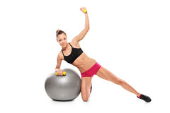 Female working out with a dumb bells Royalty Free Stock Image