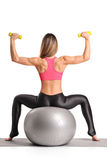 Female working out with dumb bells Stock Images