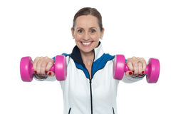 Female working out with pink dumbbells Royalty Free Stock Photo