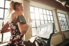 Female working out on a treadmill at gym Royalty Free Stock Image