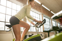 Female working out on a treadmill at gym Stock Photos