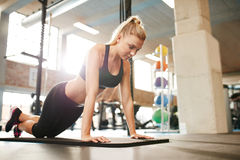 Female working out on a treadmill at gym Stock Photo