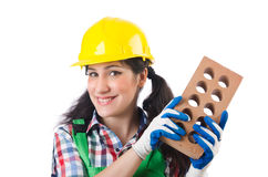 Female workman in green overalls holding brick Royalty Free Stock Photography