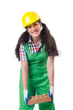 Female workman in green overalls holding brick. The female workman in green overalls holding brick isolated on white Royalty Free Stock Photos