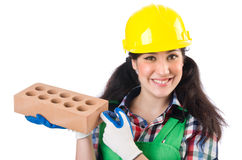 Female workman in green overalls holding brick. The female workman in green overalls holding brick isolated on white Stock Image