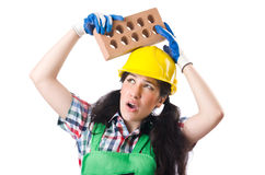 Female workman in green overalls holding brick. The female workman in green overalls holding brick isolated on white Stock Photos