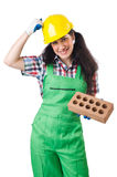 Female workman in green overalls holding brick. The female workman in green overalls holding brick isolated on white Stock Photography