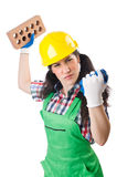 Female workman in green overalls holding brick Stock Photography
