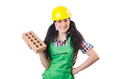 Female workman in green overalls holding brick. The female workman in green overalls holding brick isolated on white Royalty Free Stock Images