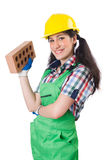 The female workman in green overalls holding brick. Female workman in green overalls holding brick isolated on white Stock Photo