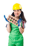 The female workman in green overalls holding brick. Female workman in green overalls holding brick isolated on white Royalty Free Stock Photography