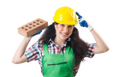 Female workman in green overalls holding brick. The female workman in green overalls holding brick  on white Stock Image
