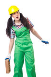 Female workman in green overalls holding brick. The female workman in green overalls holding brick  on white Stock Photo