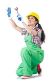 Female workman in green overalls holding key. The female workman in green overalls holding key isolated on white Royalty Free Stock Photography