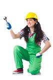 Female workman in green overalls holding key. The female workman in green overalls holding key isolated on white Royalty Free Stock Images