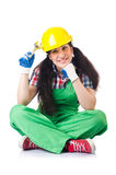 Female workman in green overalls holding key. The female workman in green overalls holding key isolated on white Royalty Free Stock Photos