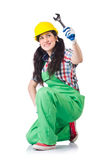 The female workman in green overalls holding key. Female workman in green overalls holding key isolated on white Royalty Free Stock Photos