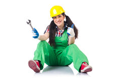 The female workman in green overalls holding key. Female workman in green overalls holding key isolated on white Royalty Free Stock Images