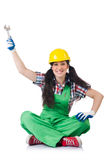 Female workman in green overalls holding key. The female workman in green overalls holding key  on white Royalty Free Stock Image