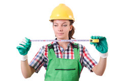 Female workman in green overalls isolated on white. The female workman in green overalls isolated on white Stock Image