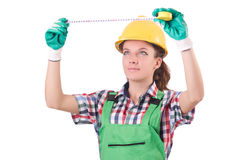 Female workman in green overalls isolated on white. The female workman in green overalls isolated on white Royalty Free Stock Image