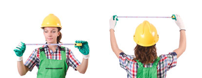 The female workman in green overalls isolated on white. Female workman in green overalls isolated on white Stock Photography