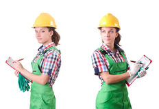 The female workman in green overalls isolated on white. Female workman in green overalls isolated on white Royalty Free Stock Images