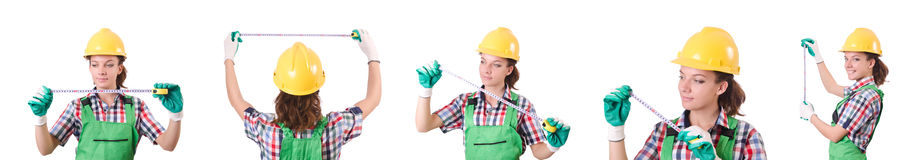 The female workman in green overalls isolated on white. Female workman in green overalls isolated on white Royalty Free Stock Photos