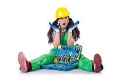 Female workman in green overalls with tool kit Stock Image