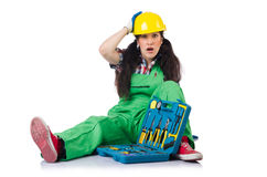 Female workman in green overalls with tool kit Stock Photos