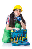 Female workman in green overalls on white. The female workman in green overalls isolated on white Stock Image